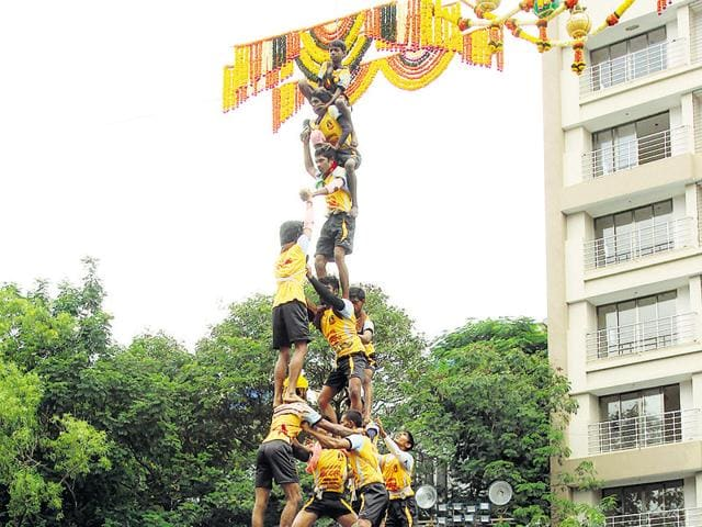 Despite police surveillance, govinda teams broke safety restrictions.