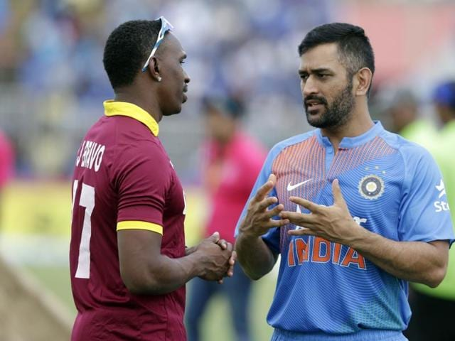 West Indies' Dwayne Bravo, left, and India's MS Dhoni, right, talk during a rain delay at the second Twenty20 .