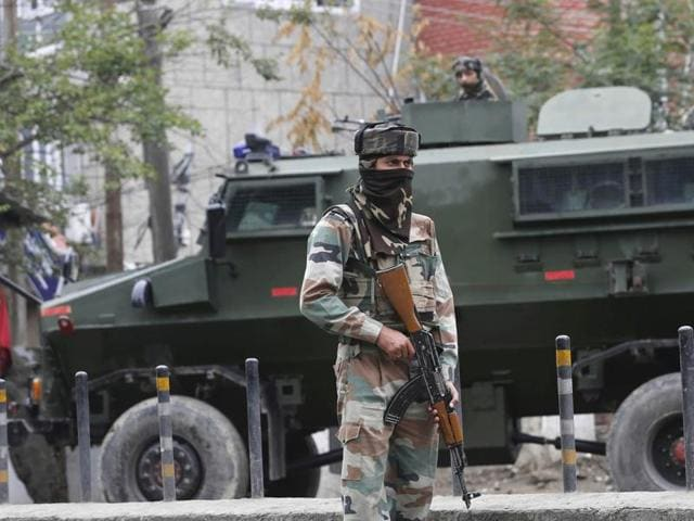 A soldier stands guard near Badam Bagh during a curfew in the Civil Lines area of Srinagar on Saturday.