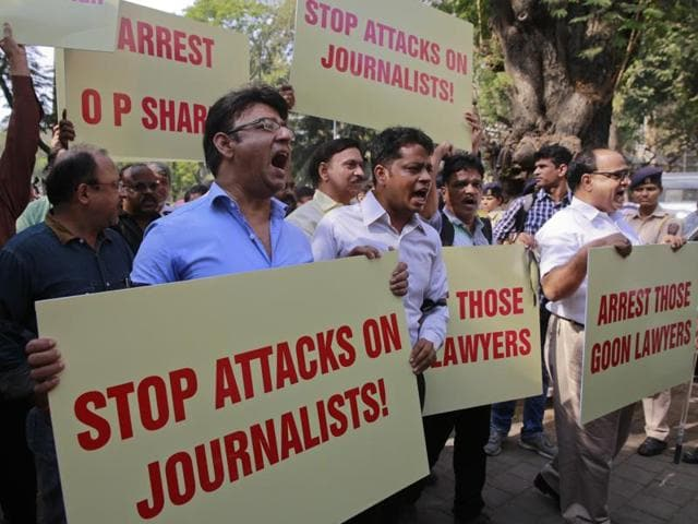 Indian journalists hold placards during a protest against attack on journalists in Mumbai. The Committee to Protect Journalists counted 27 journalists killed for their work since 1992, and noted it was still investigating more than two dozen cases to determine if those journalists' deaths were also work related.
