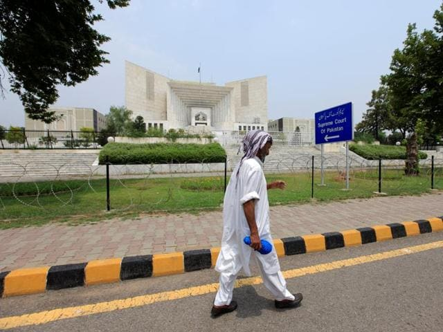 A man walks past the Supreme Court building in Islamabad, Pakistan.