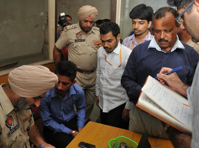 Police record statements of officials and customers at Manappuram Finance office in Rama Mandi area of Jalandhar on Monday.