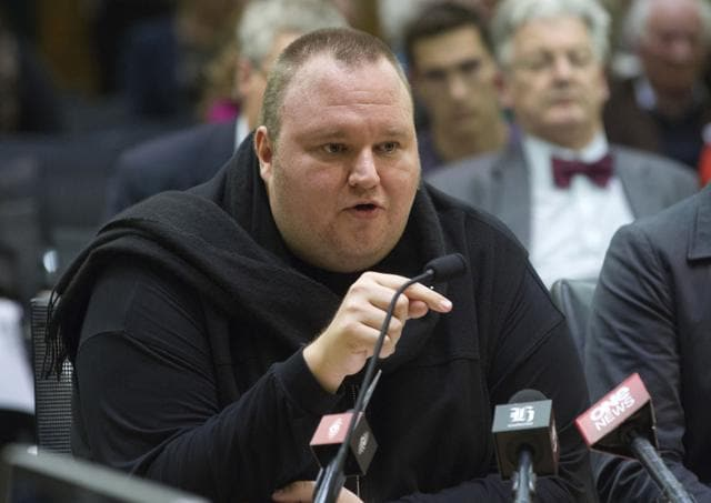 Internet entrepreneur Kim Dotcom speaks during the intelligence and security select committee hearing at Parliament in Wellington, New Zealand. Dotcom wants to livestream his legal battle against the United States on YouTube.