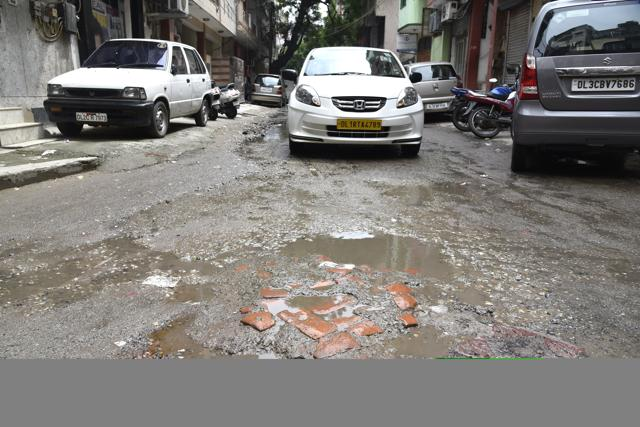 The stretch on Mathura Road near Centre for Road Research Institute has been flooded for over one week.
