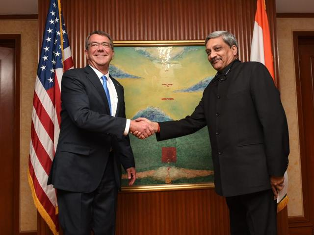 Defence minister Manohar Parrikar shakes hands with US Secretary of Defense Ashton Carter before a bilateral meeting on the sidelines of the 15th International Institute for Strategic Studies in Singapore on June 4, 2016.