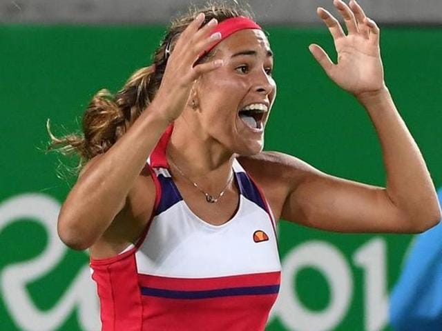 Puerto Rico's Monica Puig returns the ball to Germany's Angelique Kerber.