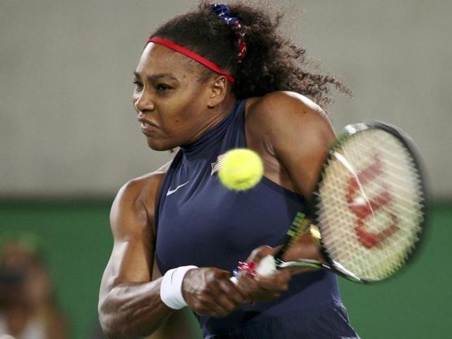 USA's Serena Williams returns the ball to Ukraine's Elina Svitolina.
