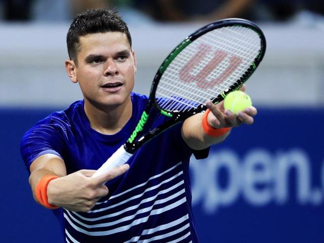 Milos Raonic of Canada serves to Dustin Brown of Germany during their first round Men's Singles match.