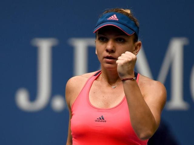 Halep celebrates a point with a fist-pump.
