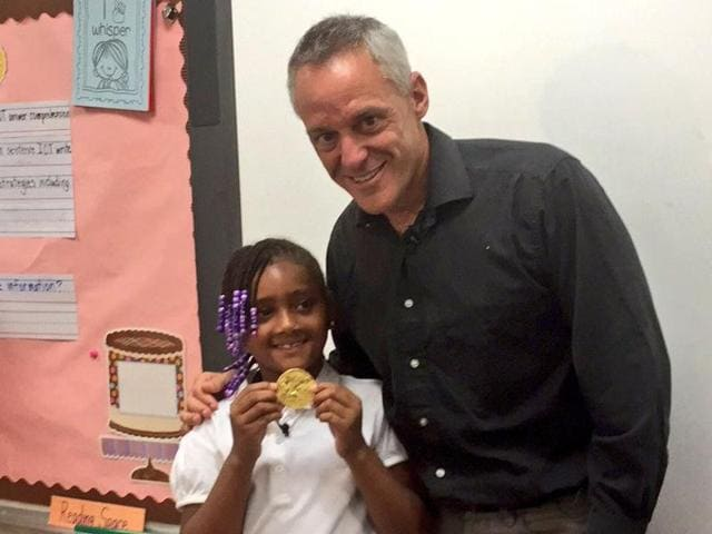 Olympic champion Joe Jacobi with Chloe Smith posing with the gold medal.