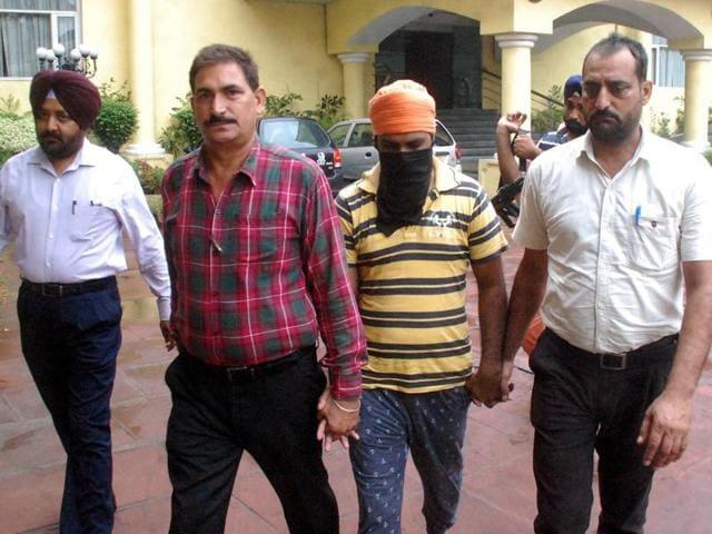The accused in police custody in SAS Nagar on Monday.