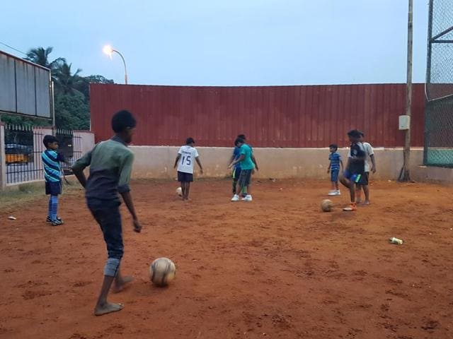 Young kids from the nearby slums at practice. Because the charity's funds are dependent on donations, the equipment and facilities they have available is sparse.