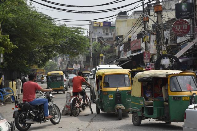 The trees and electricity poles in the middle of the road are a nuisance and dangerous, especially during monsoon.