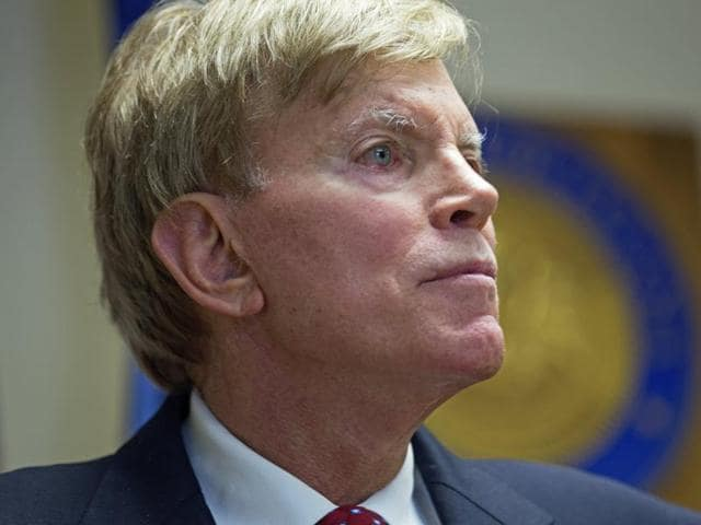 Former Ku Klux Klan leader David Duke talks to the media at the Louisiana secretary of state's office in Baton Rouge.