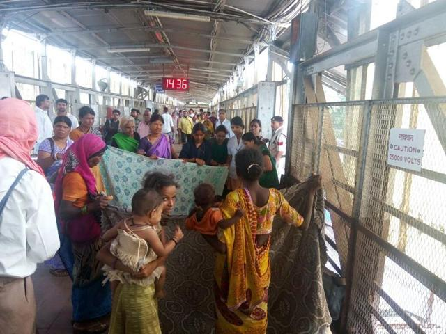 Women passengers assist Shobha to deliver the baby in a makeshift arrangement at the Itrasi railway station on Monday.