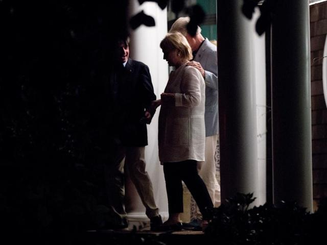 Democratic presidential candidate Hillary Clinton, second from left, and former President Bill Clinton, right, accompanied by Democratic Party activist Jay Snyder, left, leave a fundraiser at Snyder's home in East Hampton, N.Y.