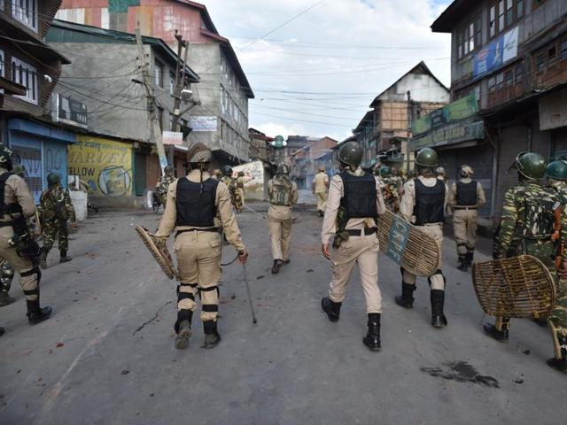 Security forces patrol a street during clashes in Srinagar on August 29, 2016.