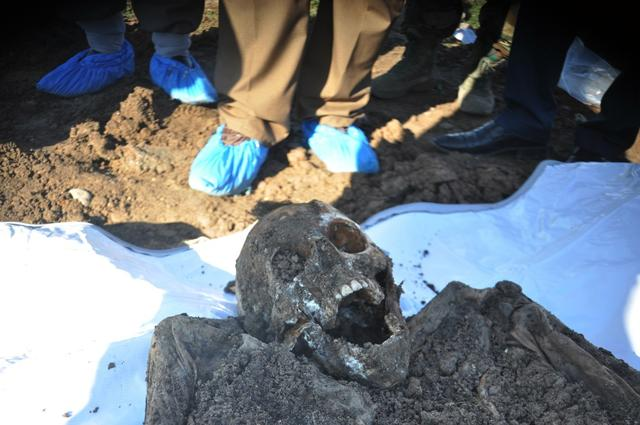 This photo released by the the Mass Graves Directorate of the Kurdish Regional Government shows a skeleton exhumed from a mass grave containing Yazidis killed by Islamic State militants in the Sinjar region of northern Iraq.
