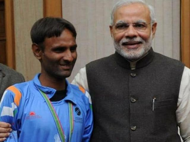 Tajinder Pal Singh with Prime Minister Narendra Modi after his team won the 2014 blind cricket world cup. The 28-year-old Jalandhar player has been waiting for the Punjab government to announce a job and reward for him.