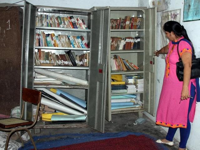 Books kept in cupboards at the Edusat Laboratory at Government Senior Secondary School, Engine Shed, in Ludhiana on Monday.