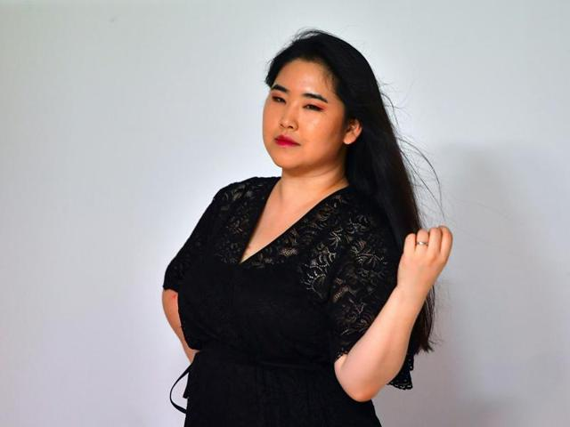 This picture taken on July 30, 2016 shows South Korean plus-size model Vivian Geeyang Kim posing for a photo shoot in order to update her online clothing shop at a studio in Seoul.