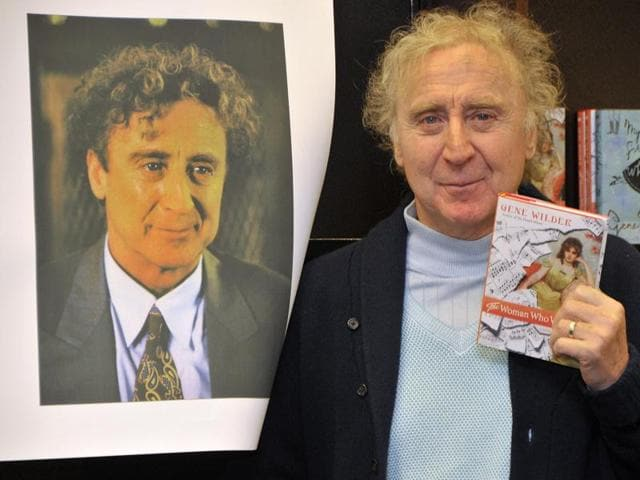 (FILES) This file photo taken on March 17, 2008 shows actor and author Gene Wilder posing with copies of his new book 'The Woman Who Wouldn't' at Barnes & Noble Bookstore at The Grove in West Hollywood, California.