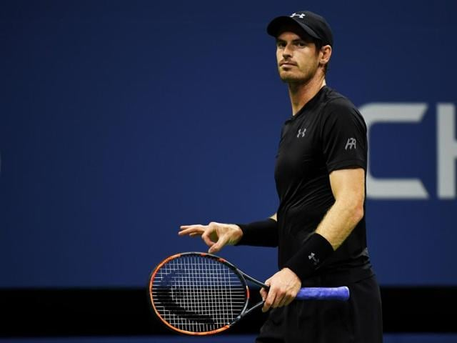 Andy Murray of Great Britain reacts during his first round Men's Singles match against Lukas Rosol.