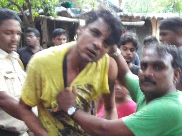 One of the accused  who was caught by locals in Andheri (West) on Tuesday after the incident.