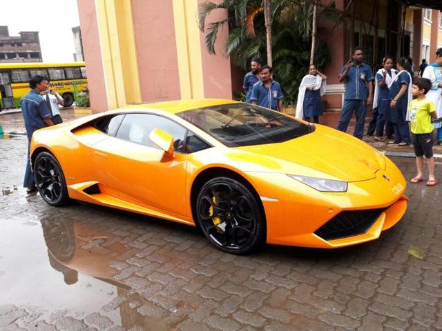 THE BJP MLA gifting a mini version of the Lamborghini to his wife before presenting her the car(HT Photo)