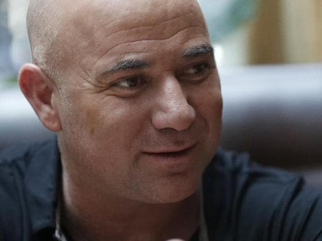 Andre Agassi speaks during an interview.