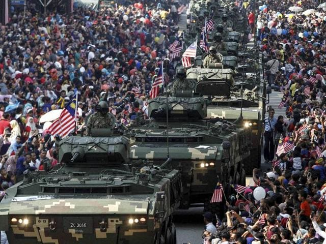 Malaysian Army tanks drive through during the 59th National Day celebrations at the Independence Square in Kuala Lumpur on Wednesday. Malaysia gained its independence on Aug. 31, 1957.