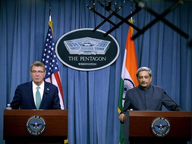 US defense secretary Ash Carter listens as defense minister Manohar Parrikar speaks during their joint news conference at the Pentagon.