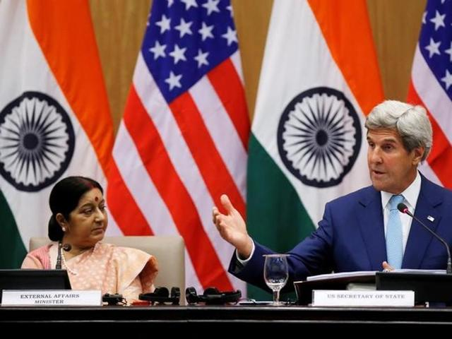 US secretary of state John Kerry (R) gestures as India's external affairs minister Sushma Swaraj looks on during their joint news conference in New Delhi.