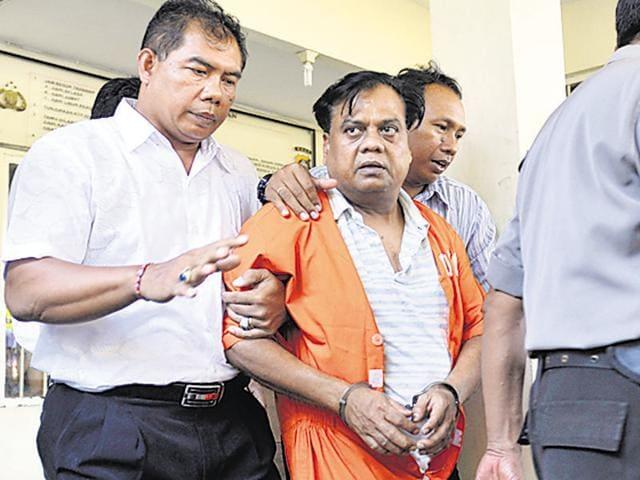 Police escort gangster Rajendra Nikalje, alias Chhota Rajan, at police headquarters in Denpasar, Bali.