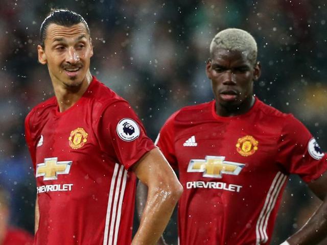 Manchester United's striker Zlatan Ibrahimovic (L) celebrates with  midfielder Paul Pogba.