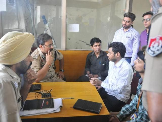 Police commissioner Arpit Shukla talking to the firm employees at the crime spot in Jalandhar on Tuesday.
