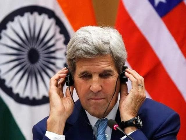 US secretary of state John Kerry adjusts during a news conference in New Delhi.