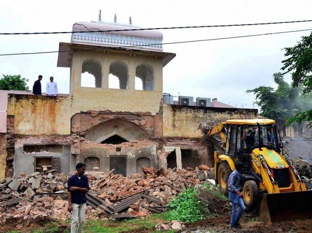 JDA workers demolish a structure at the Rajmahal Palace in Jaipur.