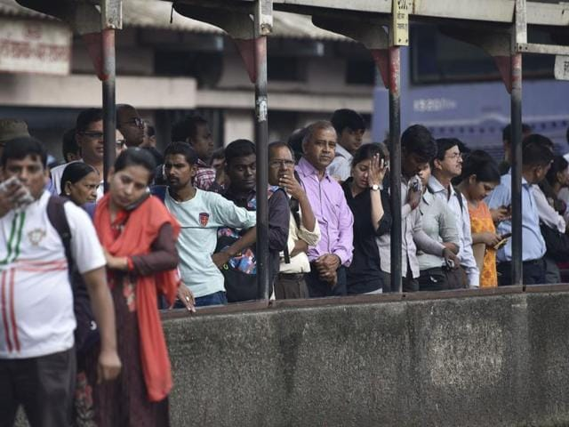 People for a bus at Kurla on Wednesday.
