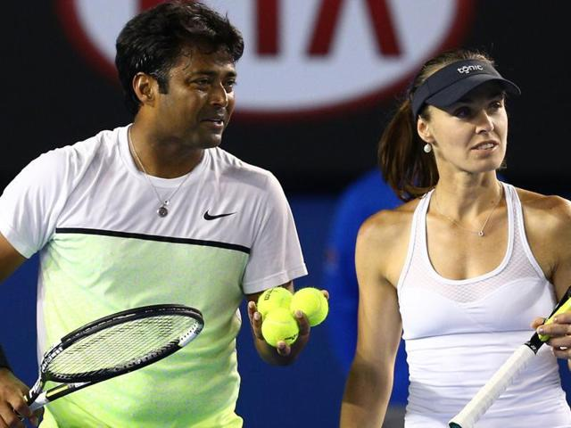 A file photo of Martina Hingis of Switzerland and Leander Paes of India.