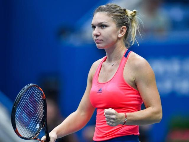 In the first match to be played from start to finish under the closed roof of Arthur Ashe, Romania's Halep triumphed 6-3, 6-4.