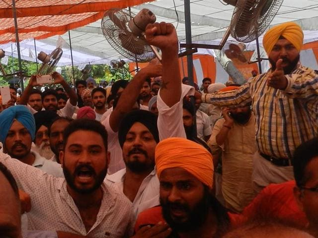 Journalists being chased out of the venue at the AAP rally in Bassi Pathana, Fatehgarh Sahib, on Thursday.