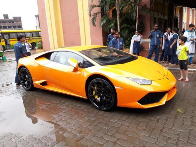 Suman Mehta poses with the Lamborghini her husband BJP MLA Narendra Mehta had gifted her