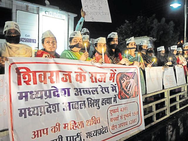 Aam Aadmi Party women-wing activists hold a candlelight march protesting against rising number of crimes against women in the state, on Wednesday in Bhopal.