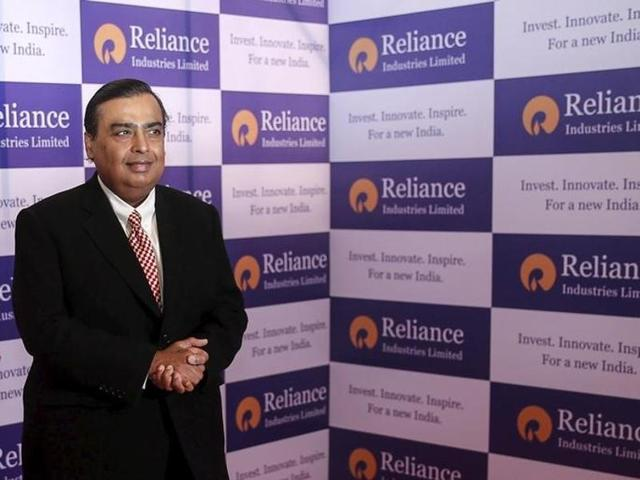 Mukesh Ambani, chairman of Reliance Industries Limited, poses for photographers before addressing the annual shareholders meeting in Mumbai.(Reuters Photo)