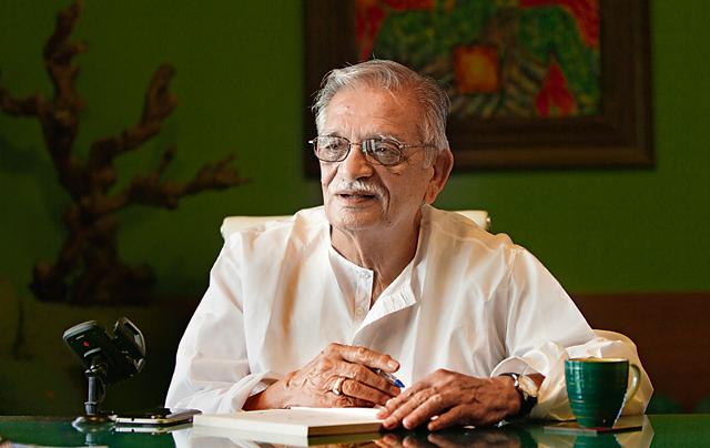 Poet, lyricist and film director Gulzar pose for the photograph at his residence Bandra in Mumbai.