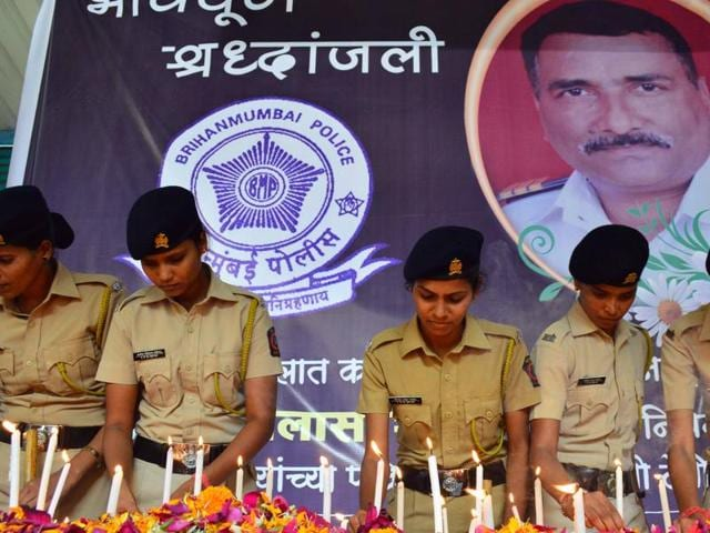 Policewomen pay tribute to the late head constable Vilas Shinde at BDD chawl, Worli, on Thursday.