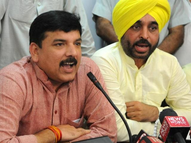 AAP Punjab affairs in-charge Sanjay Singh  and campaign committee in-charge Bhagwant Mann during a press conference in Chandigarh on Tuesday.
