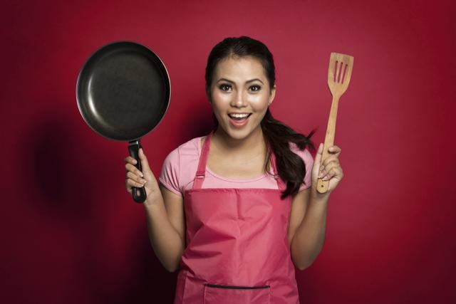 Woman is ready to cook.