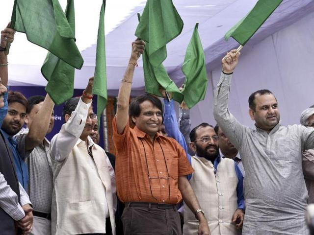 Indian railway minister Suresh Prabhu flags off 'Gatimaan' India's first semi-high speed train in New Delhi on April 5, 2016.